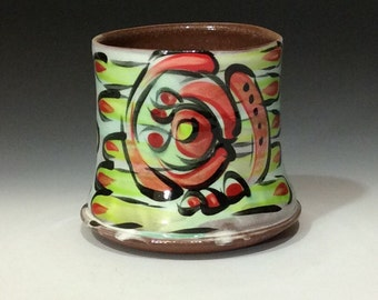 two sided cup red and green and lilac purple on white with copper splash