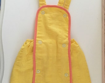 Unisex childrens yellow/orange romper sunsuit
