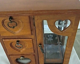 Jewelry chest, all wood with double glass door opening.  All lined and in perfect condition