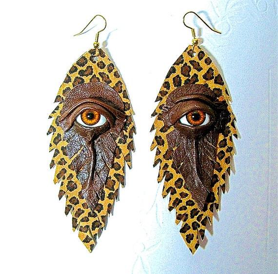 Evil eye brown leopard print leather earrings.  Leather Feather earrings. Halloween earrings. Dangle earrings. Evil eye earrings.