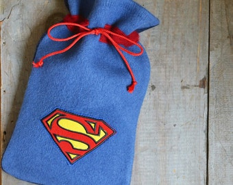 Hot water bottle cover in blue felted wool with Superman applique