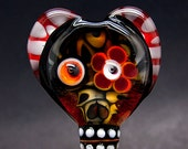 Day of the Dead in a free shaped heart bead. Created 3 dimensional including my signature in the back by Michou P. Anderson