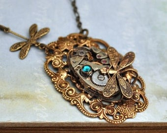 steampunk necklace - TIME TRAVELER - vintage watch movement antiqued brass necklace with tiny dragonfly