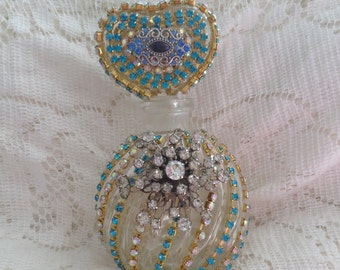 Jeweled perfume bottle, 8 inches high, inblue and white, with stopper, altered