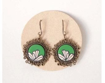 Vintage earrings. Green background