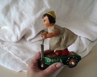 Girl on Scooter Wind Up Mechanical Toy. Made in China. 1970s