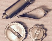Antique cookie cutters and icing tube