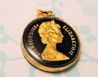 Vintage coin pendant. Enamel pound coin pendant