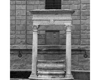 Fine Art Black & White Photography of an Old Well in a Courtyard in the Tuscan Hill Town of  Pienza Italy