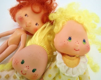 Lot of 3 Strawberry Shortcake Dolls Lemon Meringue 80s Baby Butter Cookie Yellow poseable dolls.