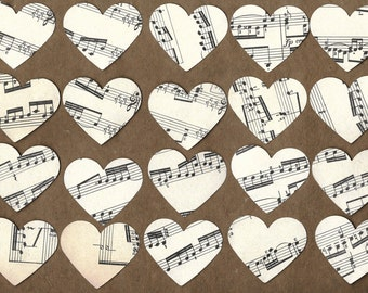 20 large paper hearts punched from vintage sheet music
