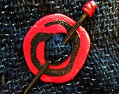 Shawl pin in red and black swirl texture