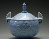 light blue porcelain zombie lidded jar