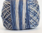 Blue and grey self-striping sock yarn   Round Table Yarns Merlin in Once and Future