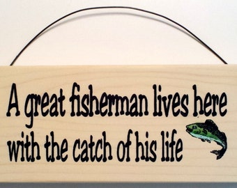 A Great Fisherman Lives Here With The Catch of His Life sign
