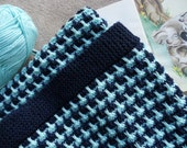Baby blanket/coverlet/afghan, suitable for stroller or pram. Hand knitted in navy blue and aqua merino yarn, approx 32 in x 22 ins