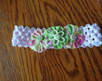 Infant headband in pink with pink,yellow,and green yo-yo flowers