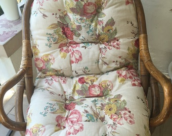 BRAND NEW Rattan CUSHION, Upholstered in a floral heavy duty linen fabric with zipper and handmade buttons. cushion only, chair not included