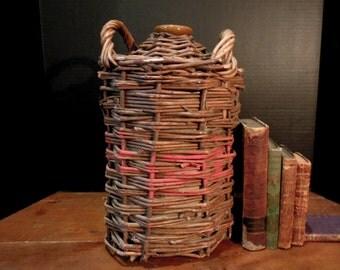 Vintage Whiskey Demijohn Wrapped in Wicker / Woven Wicker Demijohn
