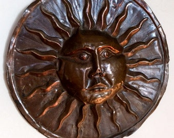 Vintage copper sun wall hanging.