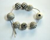 Ways to die in space -- 8 b&w ceramic art beads