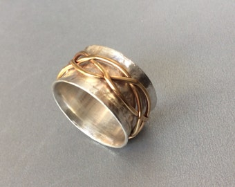 Sterling silver spinner ring with brass free form spinner band