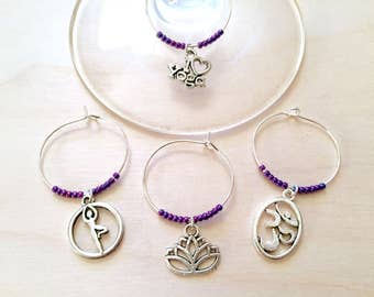 Yoga Wine Charms: Yoga Themed Wine Charms. Perfect gift for the Yogi in your life. Includes Om, Lotus Flower, Namaste, Tree Pose. Set of 4.