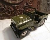 "Vintage 1960s era, ""TONKA' Army jeep!"