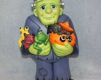 RESERVED FOR RYAN - Handpainted Ceramic Frankenstein holding several spooky little Monsters and a Jack O'Lantern