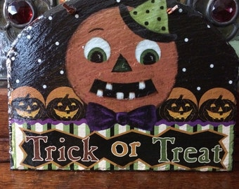 Halloween Jack-O-Lantern Trick ot Treat Sign on Roof Slate Tile