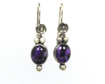 Silver and amethyst earrings with handmade silver flower