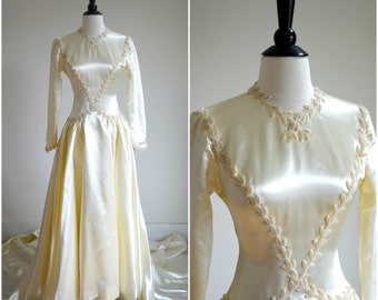 Vintage 1930's satin wedding gown with beaded embellishment / ivory long sleeved wedding dress / button back / long train