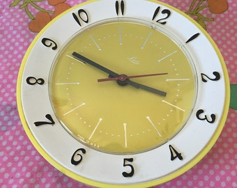 Vintage yellow electrical clock