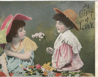 "Little boy giving flowers to a little girl ""Gift of Love"" Vintage Postcard 1908"