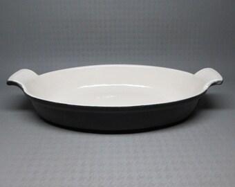 tab handled cast iron baker , black exterior ivory white interior