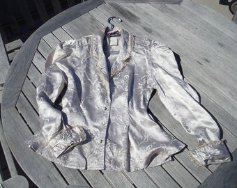 Metallic blouse with statement sleeve