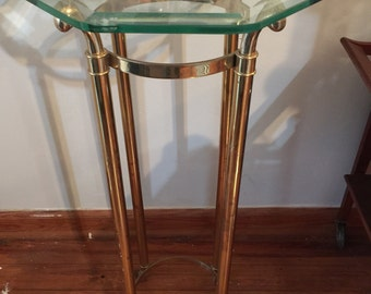 Solid brass footed tall shelf Hollywood Regency style. Original glass. Interior design