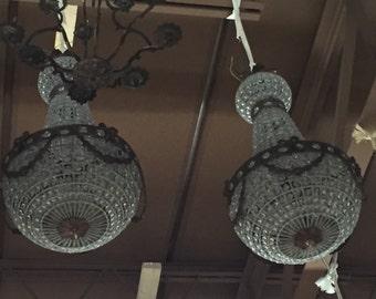 Swag details empire chandelier. Pair of chandeliers. Interior design. Large chandelier