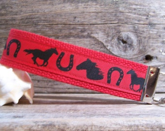 Red horse key fob  , key ring in red with horse head and horse shoe , key fob , equestrian ,strap,wrist strap , riding