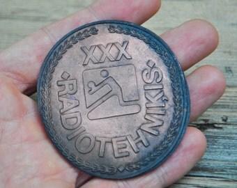 """Vintage Latvian copper sport medal.""""Radiotehnika-volleyball""""."""