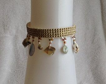 Handmade elegant ankle bracelet 9.5 in long. Seashells and gold studs