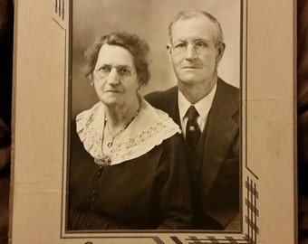 Instant grandparents ~ antique black and white photo of elderly couple in cardboard frame stand