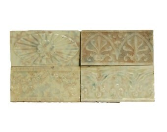 Set of four pastel decorative tiles