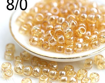 10g TOHO Seed glass beads, size 8/0, Trans Lustered Light Topaz, N 103, round rocailles - S1048
