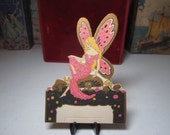 Gorgeous unused die cut gold gilded fantasy art deco 1920's place card female fairy with antennas and pink wings ,dress sits on mushroom