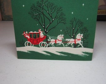 Colorful embossed unused 1950's A Sunshine card christmas card red victorian coach with white horses and scenes of ice skating inside