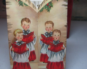 Colorful die cut gold gilded embossed 1950's christmas card with boys choir singing Joy to the World musical notes and words to song inside