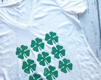 Women's Saint Patrick's Day Tri Blend short sleeve, v-neck with Many Shamrocks Signature design. Irish St Pattys Lucky Shirt for woman.