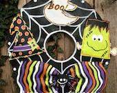 Screen Wire Halloween Wreath with Frankenstein, Witches Hat, Ghost and Spider Door Hanger!