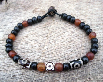 Mens surfer bracelet, etched agate dzi, horn and dyed bone beads, on strong cord with a toggle and loop clasp, tribal style, handmade